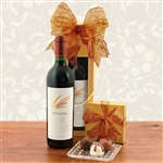 A bottle of Opus One Overture Varietal Red Wine in a Golden Wine Gift Box with Truffles