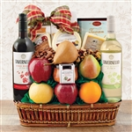 Bamboo basket with white wine, red wine, cheese and fruit