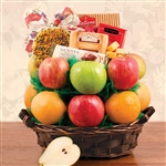 Basket with 11 pieces of fruit, an autumn decorated cookie, cheese, crackers and chocolate.