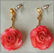 Miniature Pink Wild roses have been preserved in a clear lacquer finish and trimmed in gold. Rose earrings make great jewelry gifts. Check out our gold rose jewelry line for more unique gift ideas. #gift