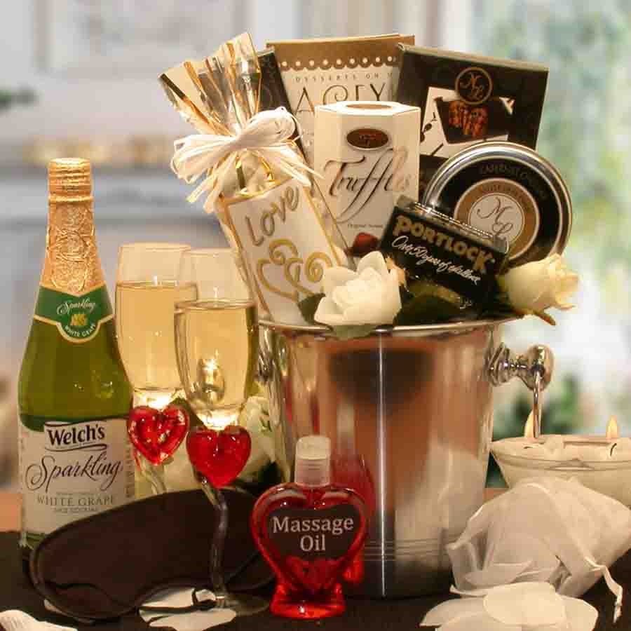 All the essentials for an evening of true romance for all of the senses are packed in a champagne bucket. Any couple is going to have a great date night when they start with this romantic basket. This romantic gift basket features everything you need to d #gift