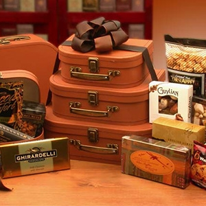 Gourmet Gift Tower is three tiered faux leather suitcases filled with treats