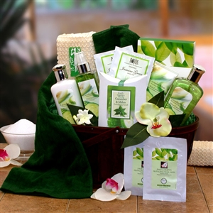Bamboo gift basket filled with all the things you need for a spa day featuring, high quality aromatic combination scents of cucumbers and melons.