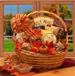 A natural willow basket fills with favorite snacks and bright autumn colored leaves ket