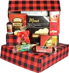 A red and black plaid gift box filled with sausage, cheese, cookies, nuts, and more.