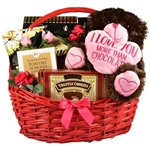"14 inch plush Teddy Bear holding a heart that says ""I Love You More Than Chocolate"" and tucked in a large red Basket among a load of Valentine treats"