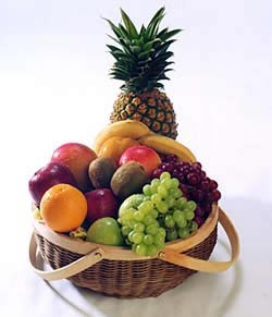 Tropical and traditional fruits gathered tastefully together. - Elegant Classics Fruit-Deluxe (Shown)
