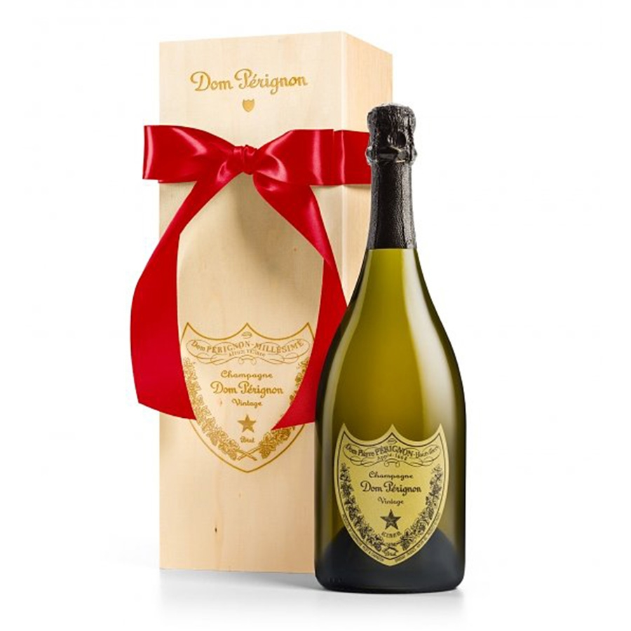 Even if you have to make up a special occasion just to celebrate, enjoy a bottle of this fine champagne. The celebratory experience begins with a metallic-accented wine box that opens to reveal a bottle of 2002 Dom Perignon Champagne and two glass flutes. #gift
