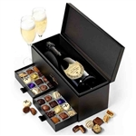 Dom Perignon Champagne and Chocolates boxed together in an elegant box with a drawer for the chocolates
