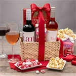 Woven basket with two bottles of wine and Valentines treats
