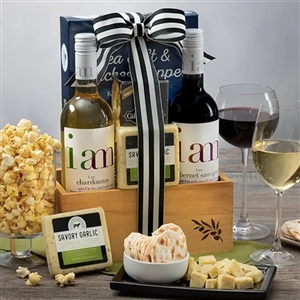 Woven basket with two bottles of wine and Easter treats