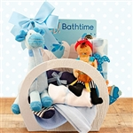 A basket for the new baby boy that includes baby sleeper, socks, cap, receiving blanket, bib and more!