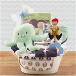 A metal tin basket loaded with all the necessities for the new baby boy!