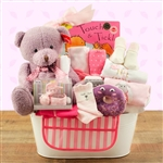 Lovely basket with items to pamper the new baby girl.