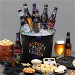 For Adult Halloween Gifting. A black cauldron pail filled with the best Halloween treats, 5 bottles of beer and 1 bottle of hard cider.