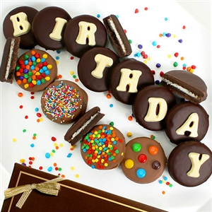 "Oreo® Cookies dipped in Belgian Chocolate with icing spelling out ""Birthday"""