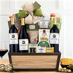 A gourmet gift basket with three Steeplechase red wines and Assortment of Goodies