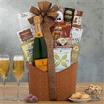 Yellow Label Veuve Clicquot Champagne Basket accompanied by chocolate delights.