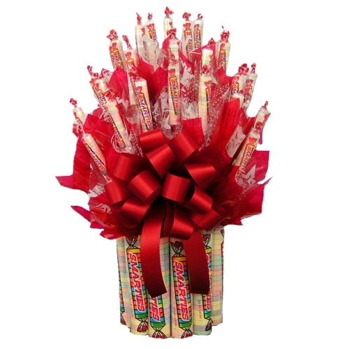 Our Smarties Candy Bouquet is the perfect gift for the smarty on your gift list. The bouquet features large and fun sized packages of Smarties candies arranged into a sweet and spectacular bouquet. This candy bouquet would make an excellent gift for a chi #gift