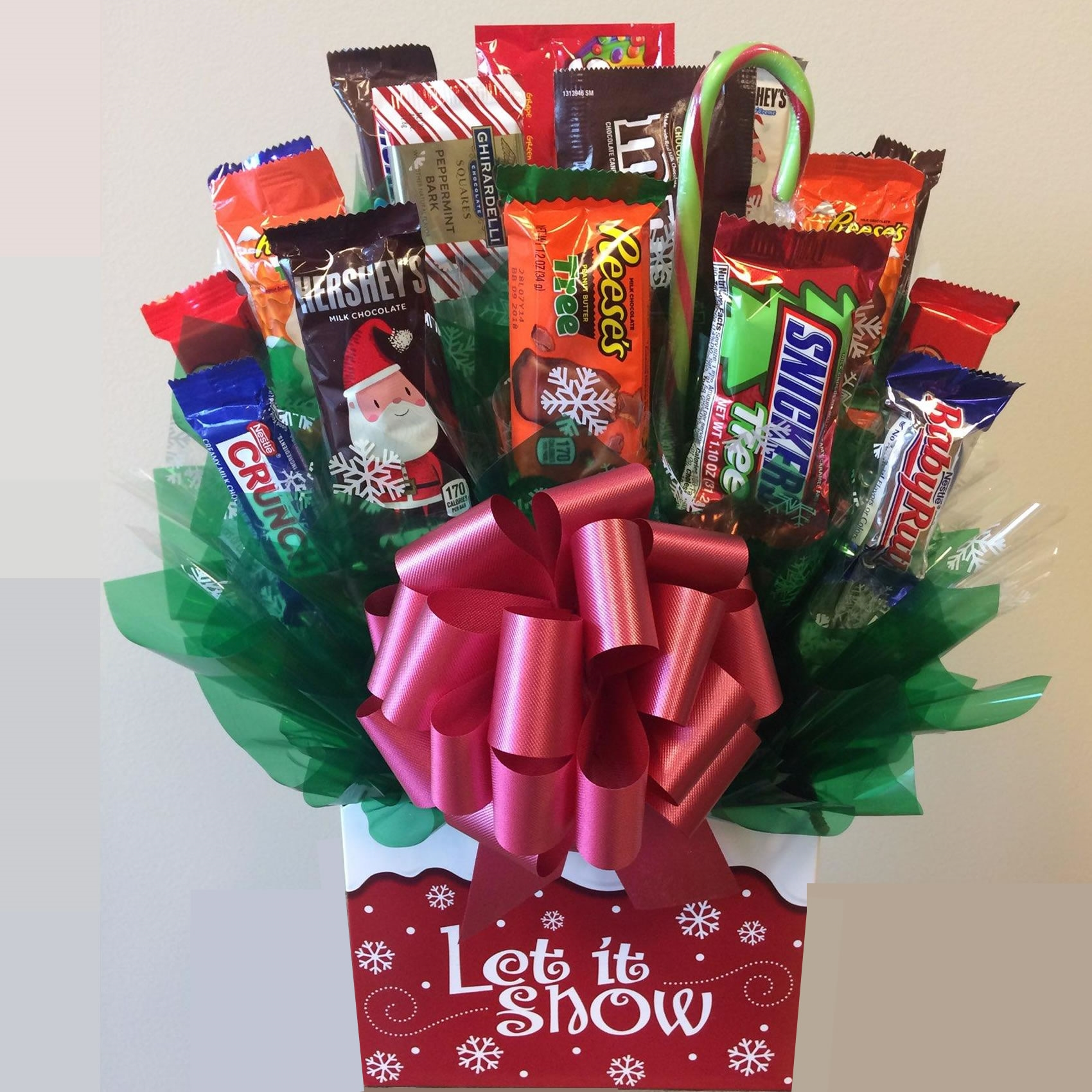 Features a delightful snowflake designer gift box. The entire family is sure to enjoy sharing a collection full and fun size chocolate bars and candies. This candy bouquet replaces a fresh flower gift and is an ideal to send for any winter holiday or occ #gift