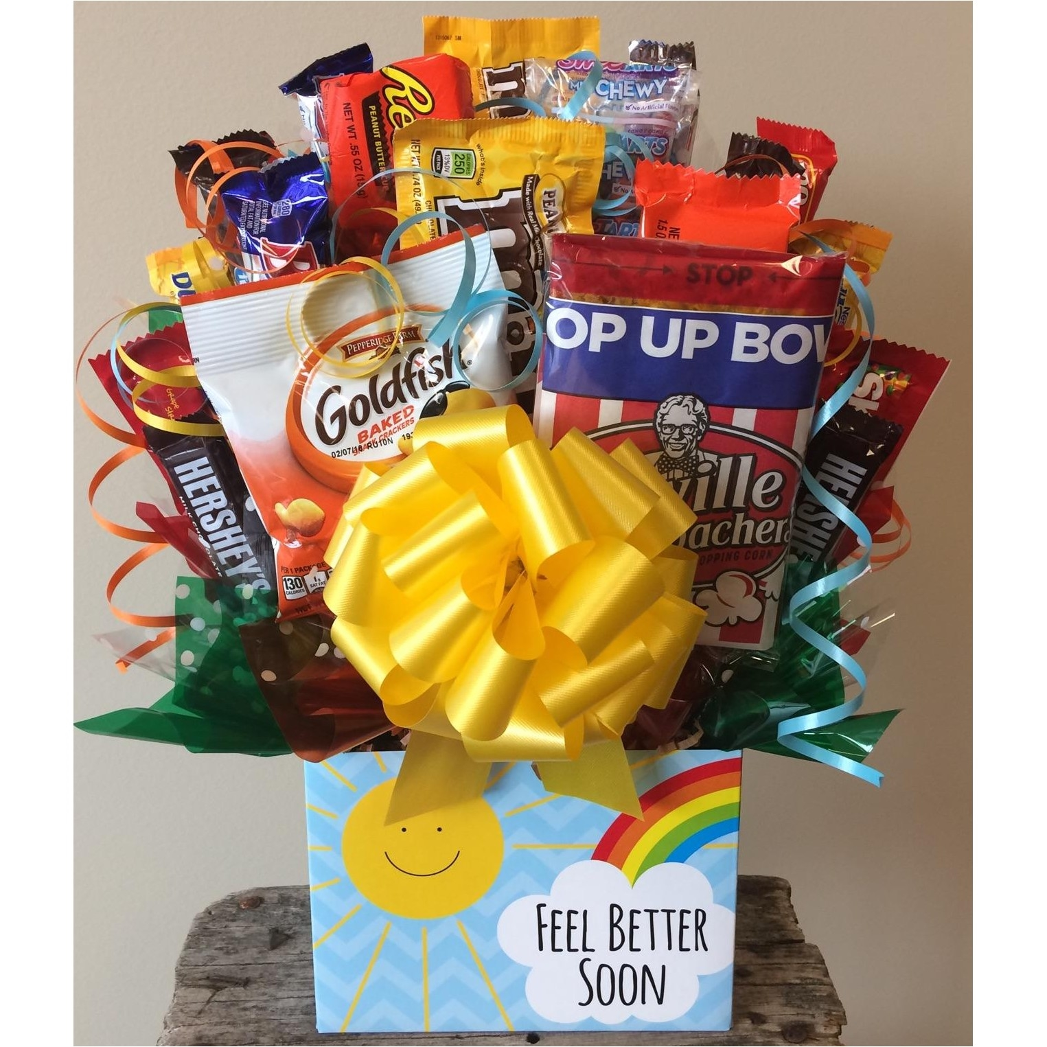 Give them a reason to feel better soon with tasty chocolates, candies, and snacks. Do you have a friend or family member recuperating from a sickness or injury? If so put a smile on their face with this Get Well Candy Bouquet filled with junk food treats #gift
