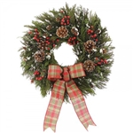 Alpine Chalet Wreath is made on a base of premium preserved cedar with pine cones, decorative red berries and a plaid bow.