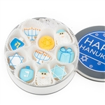 A round tin of iced vanilla sugar cookies decorated for Hanukkah.