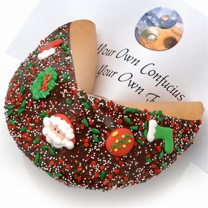 Giant Christmas Fortune Cookie includes your message inside as a 1 ft long fortune. Giant Fortune Cookie is dipped in your choice of chocolate and adorned with tasty holiday decorations.