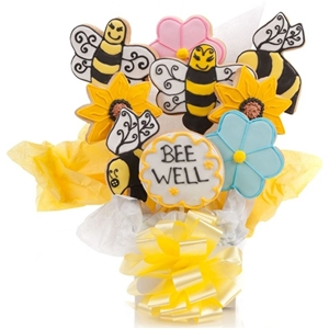 A vanilla sugar cookie arrangement with shapes of bees and flowers, and your own personalization on a cookie to customize for any occasion.