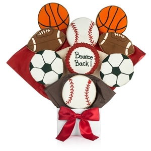 Bouquet of sugar cookies shaped and decorated like basketballs, footballs, soccer balls, and basketballs with customized text on one cookie.