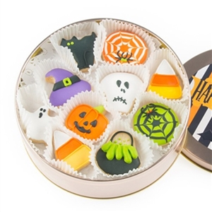 A round tin with 16 iced vanilla sugar cookies decorated for Hallowee.
