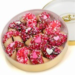 Romantic Wheel of Fortunes - A collection of dipped fortune cookies decorated with hearts and sprinkles.
